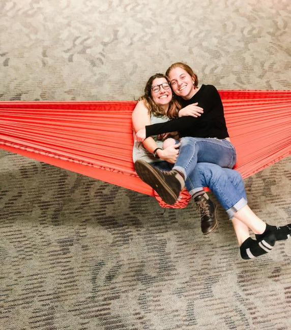 freinds cuddle together for a picture in a hammock