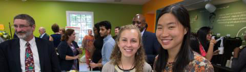 Two students pose for a photo at the Spencer Weinstein Center for Community and Justice Reception