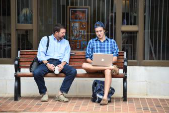 Prof Krentz with Student on a Bench