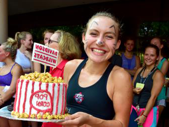 Cake race winner holds a cake