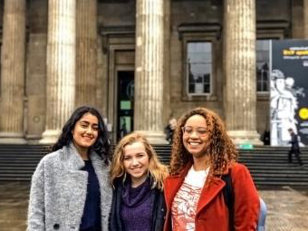 Students pose in front of museum steps in London