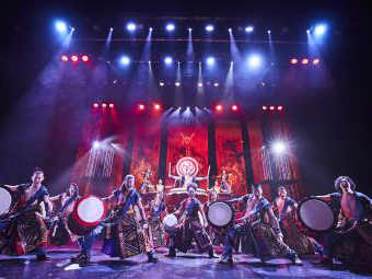 Yamato Drummers on stage with bright lights