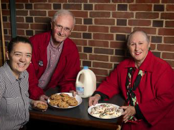 Harriet Kessler, Dennis Appleyard, and Grace Cain '20 with plates of cookies