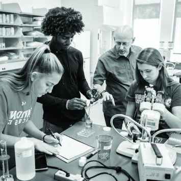 Professor and Students in the lab